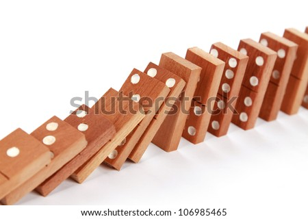 domino falling isolated on white as an abstract concept - stock photo