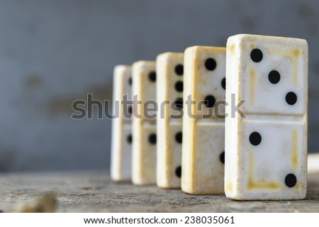 Domino game pieces in a row - stock photo