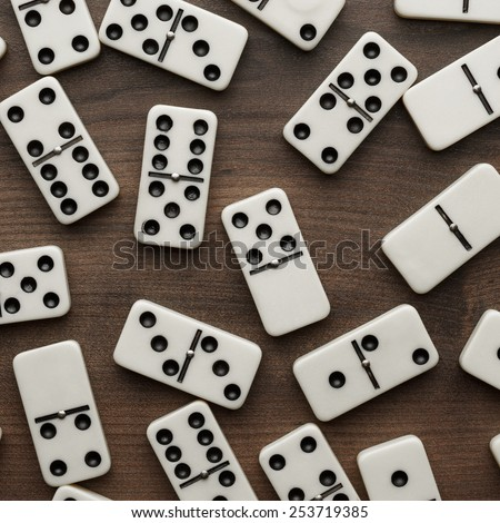 domino pieces on the brown wooden table background - stock photo