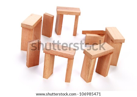 domino stonehenge isolated on white as an abstract concept - stock photo