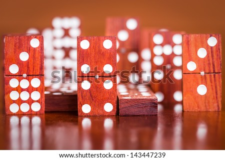 Domino tile with out of focus pieces in the background - stock photo