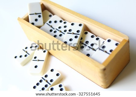 dominoes and wood box isolated on white background