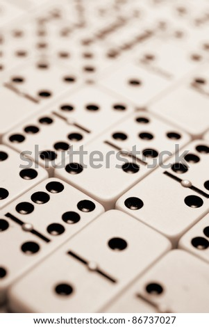 Dominoes in Sepia Tone - stock photo