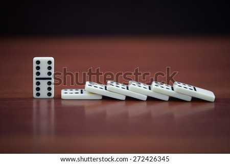 Dominoes on a dark table with a small depth of field - stock photo