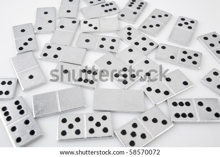 Dominoes on white background, close up - stock photo