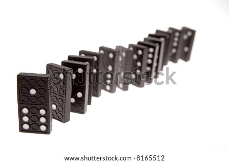 Dominoes standing in a row over white background