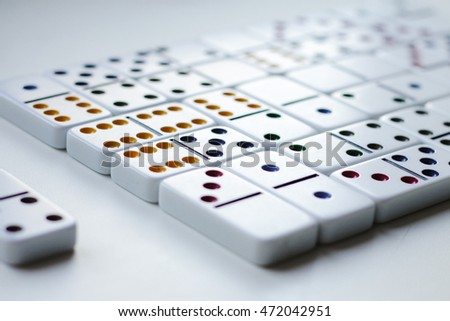 dominoes with colored dots on a white background