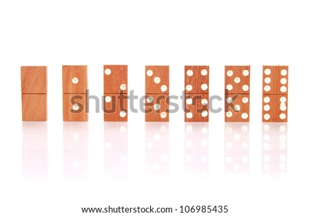 dominos with reflection isolated on white as an abstract concept - stock photo