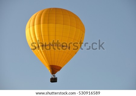 DOMME_ FRANCE,28 JULY, 2016: Hot air balloon in the sky of Domme in Dordogne