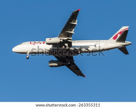 Domodedovo - March 17, 2015: Airbus A320 passenger aircraft, the airline Qatar Airways, landing at Domodedovo airport March 17, 2015, Domodedovo, Moscow Region, Russia - stock photo