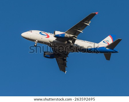 Domodedovo - March 17, 2015: Red, blue and white passenger aircraft Airbus A319, airlines Ural Airlines landing at Domodedovo airport March 17, 2015, Domodedovo, Moscow Region, Russia
