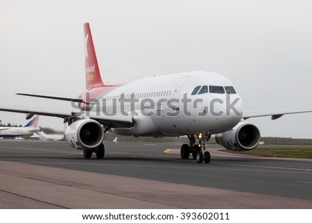 DOMODEDOVO, MOSCOW REGION, RUSSIA - APRIL 28, 2014: Airplanes at Domodedovo international airport. NordWind Airlines Airbus A320 taxiing to the runway