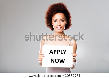don't be scared and apply now says this young afroamerican woman - stock photo