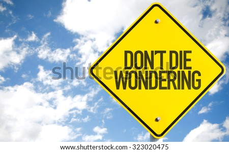 Don't Die Wondering sign with sky background