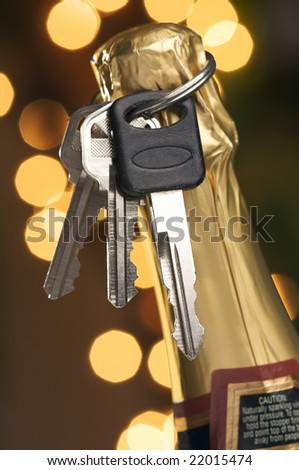 Don't Drink and Drive - Keys and Champagne in Holiday Abstract Background. - stock photo