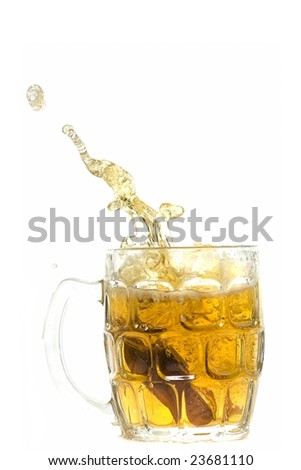 Don't drink and drive.  Keys dropped into a beer. - stock photo