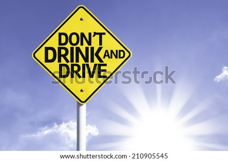 Don't Drink and Drive road sign with sun background  - stock photo