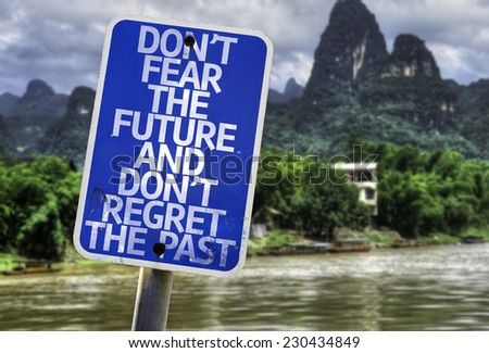 Don't Fear The Future and Don't Regret The Past sign with a forest background - stock photo