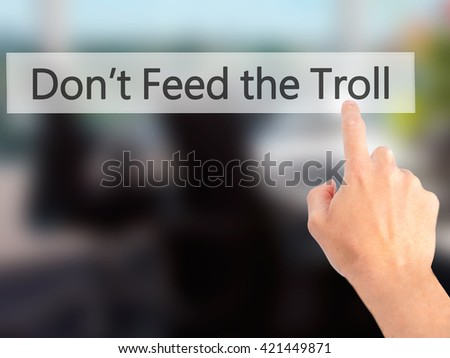 Don't Feed the Troll - Hand pressing a button on blurred background concept . Business, technology, internet concept. Stock Photo - stock photo