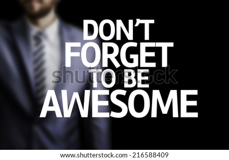 Don't Forget to Be Awesome written on a board with a business man on background - stock photo