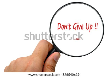 Don't Give Up word. Magnifier and puzzles. - stock photo