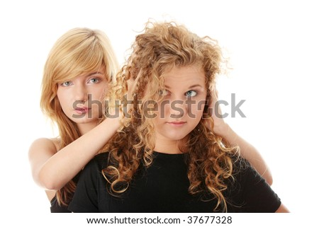 Don't listen - censorship concept - two teens isolated on white - stock photo