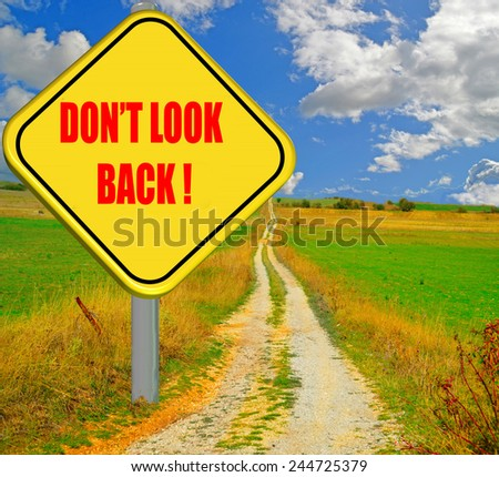don't look back , yellow traffic sign, long street - stock photo