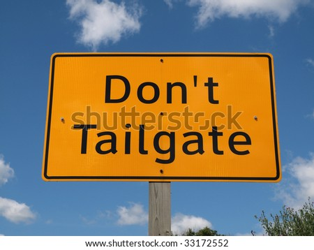 Don't tail gate highway sign on a bright sunny day.