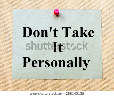 Don't Take It Personally written on paper note pinned with red thumbtack on wooden board. Business conceptual Image - stock photo