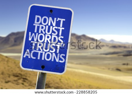 Don't Trust Words, Trust Actions sign with a desert background - stock photo