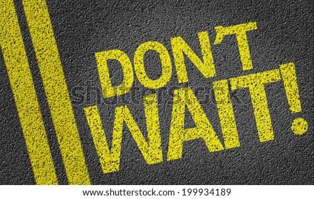 Don't Wait written on the road - stock photo