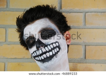 Don't wake him up, portrait of a creepy skeleton guy perfect for Carnival (brick wall background) - stock photo