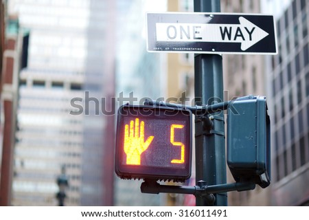 Don't walk New York traffic sign on blurred background - stock photo