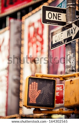 Don't walk New York traffic sign with illuminated and blurred background - stock photo