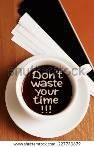 Don't Waste Your Time - Motivational concept written on a cup of coffee - stock photo