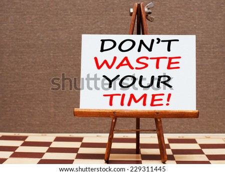 Don't Waste Your Time! Motivational concept written on easel - stock photo