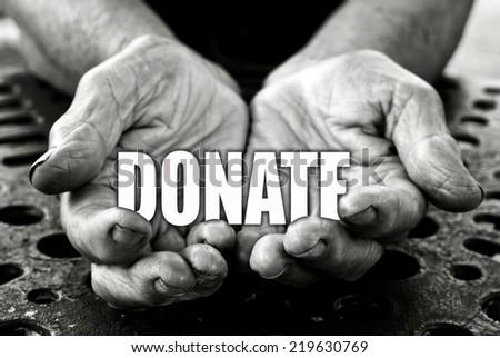 Donate concept in the old female hands  - stock photo
