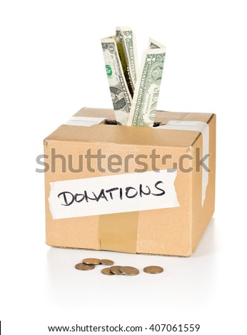 Donation carton box with dollar bills and coins over white background - stock photo