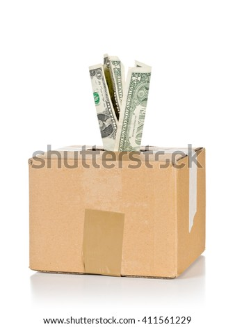 Donation carton box with dollar bills over white background - stock photo