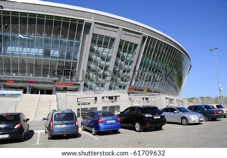 DONBASS-ARENA, DONETSK, UKRAINE - SEPT 25: Shakhtar Donetsk's new soccer stadium September 25, 2010 in Donetsk, Ukraine. It is constructed for carrying out of the championship of Euro 2012. Parking. - stock photo