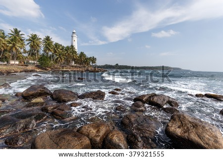 Dondra Head Lighthouse, Sri Lanka. One of the tallest in South East Asia. Beautiful landscape tropical rocky beach.