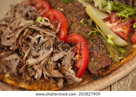 Doner Adana Kebab with Lahmacun - Turkish pizza pide - stock photo