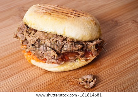 Doner kebab sandwich isolated on wooden board