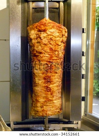 doner kebab shop with grilled lamb on a spit - stock photo
