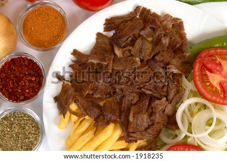 doner kebab with french fries and salads - stock photo