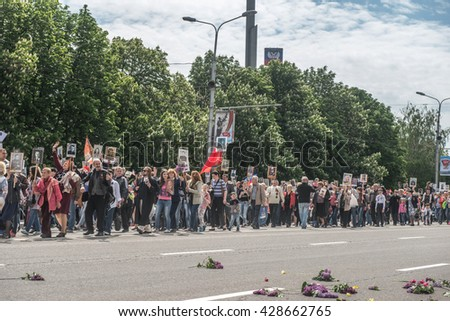 DONETSK, Donetsk People Republic. May 9: Immortal Regiment on march the main street of the Donetsk city during Victory Day Parade. 2016, May 9.
