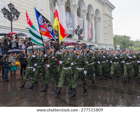 Donetsk - May, 9, 2015: National Guard Donetsk People's Republic at the military parade in honor of the anniversary of the victory over fascism in World War II - stock photo