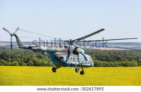 DONETSK REG, UKRAINE - Aug 02, 2015: Ukrainian military helicopter Mi-8 (Hip) in flight on combat duty in the area of the antiterrorist operation - stock photo