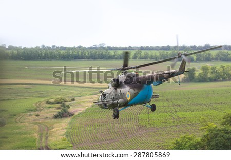 DONETSK REG, UKRAINE - Jun 11, 2015: Ukrainian military helicopter in flight on combat duty in the area of the antiterrorist operation - stock photo