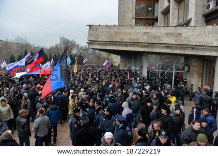 DONETSK, UKRAINE - 10 APRIL 2014: Russian demonstrators protests and blockade of donetsk goverment during Ukrainian revolution on APRIL 10, 2014 in Donetsk, Ukraine. - stock photo